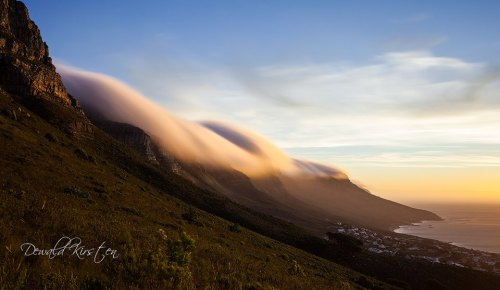 Clouds rolling over the 12 Apostles above Camps Bay in Cape Town.