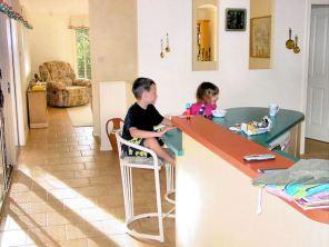 DSC00596 kids at the kitchen bench E
